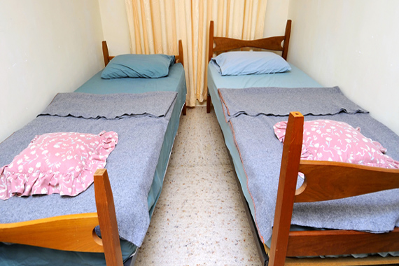 Twin beds in simple motel room