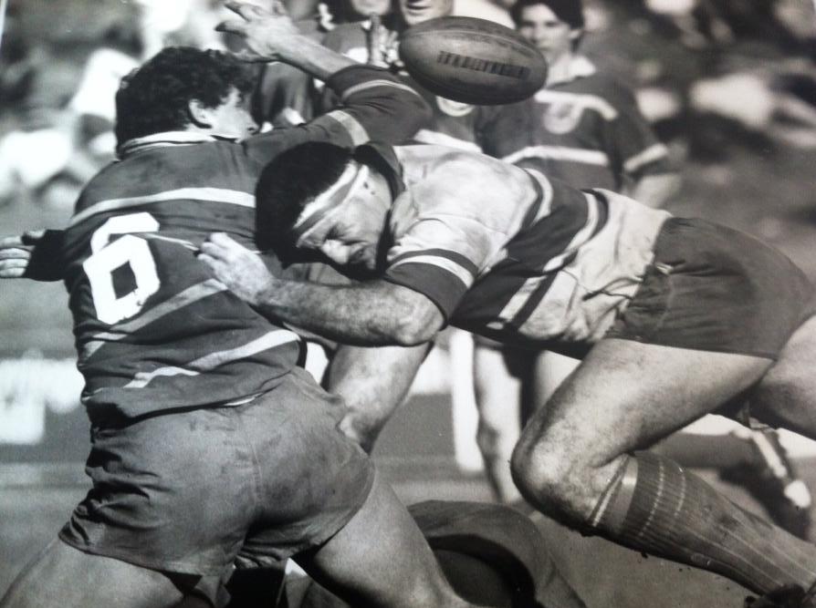 Malloy tackling Andrew McCalman